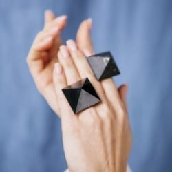 Shungite ring with a polished pyramid on a silver band