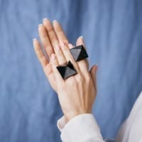 Shungite ring with a polished pyramid on a copper band
