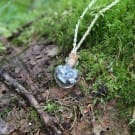 Necklace with an elite shungite crystal shaped bottle