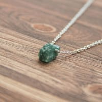Green aventurine necklace on a chain with a raw bead