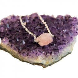 Rose quartz necklace on a chain with a raw bead