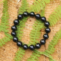 Shungite bracelet with round 9 mm beads and black marbles on elastic band