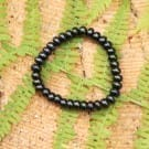Shungite bracelet with oval (rondelle) beads on elastic band